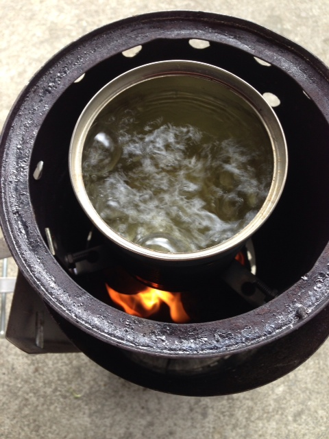 Pot in the flue as was done in the Swiss Volcano Stove.